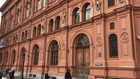 Riga, Latvia, A group of people standing in front of a building Live Action