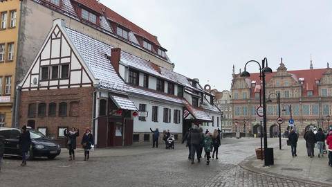 Gdansk, Poland, February 20 2017: A group of people walking down a street next Live Action