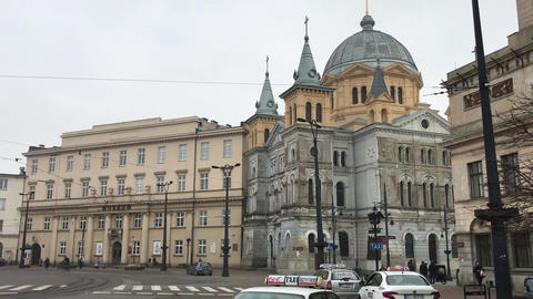 Lodz, Poland, A close up of a busy city street in front of a building Live Action