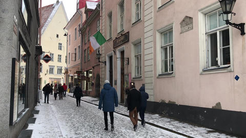 Tallinn, Estonia, February 18 2017: A group of people walking on a city street Live Action