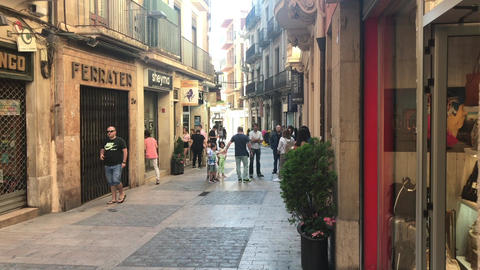 Reus, Spain, June 27 2019: A group of people walking on a city street Live Action