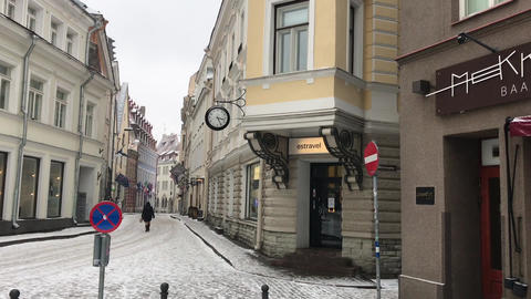 Tallinn, Estonia, A person walking down a street in front of a building Live Action