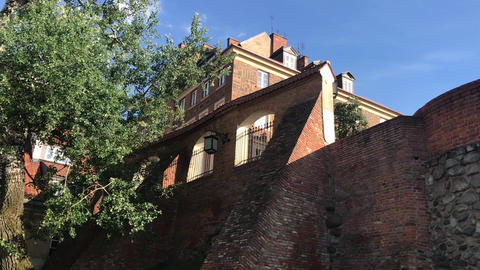 Warszawa, Poland, A tree in front of a brick building Live Action