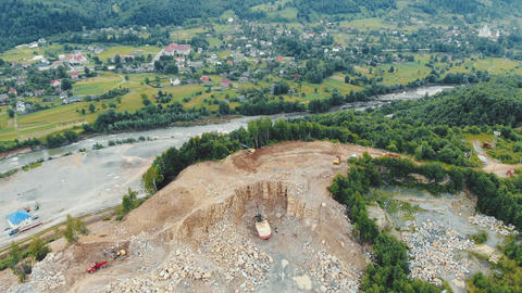 Aerial view Flight over a quarry in the mountains where stones and other rocks Live Action