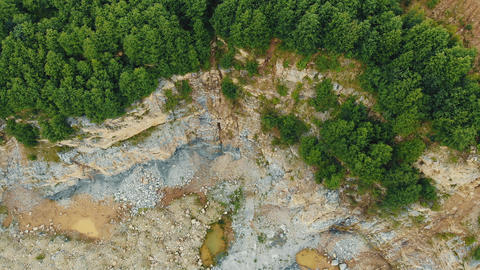Aerial view on top quarry in the mountains for the extraction of stones. Rocky Live Action