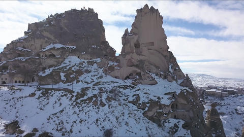 Cappadocia, Turkey. Aerial View of Mountain Castle and Uchisar City Under Snow Live Action