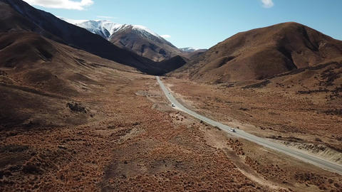 New Zealand. Aerial View of Landscape, Cars on Valley Road Under Southern Alps Live Action
