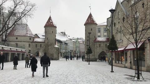 Tallinn, Estonia, February 18 2017: A group of people walking in front of a Live Action