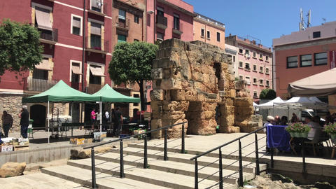 Tarragona, Spain, A group of people in front of a brick building Live Action