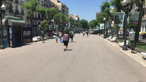 Tarragona, Spain, June 30 2019: A group of people walking on a city street Live Action