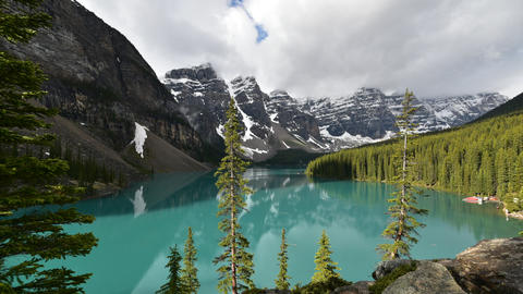 A timelapse movie of Moraine Lake taken on a sunny morning. mirror Live Action