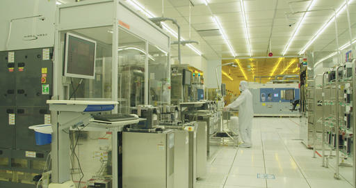 Workers in clean suits in a semiconductor manufacturing facility Live Action