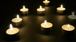 Candles on black table Footage