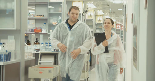 Lab technicians working in a pharmaceutical laboratory Footage