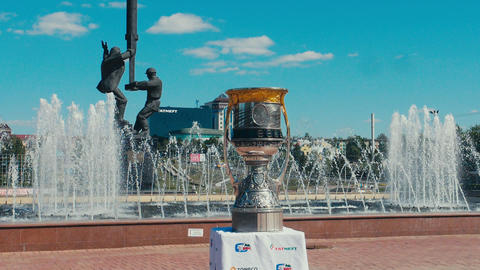 sports cup with Yuri Gagarin at fountain and miners monument Live Action