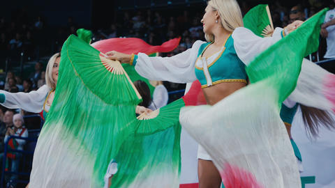 cheerleaders in Tatars style suits dance with fan fabric Live Action