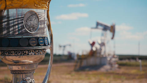 shiny cup with Yuri Gagarin against pump jacks in oil field ライブ動画