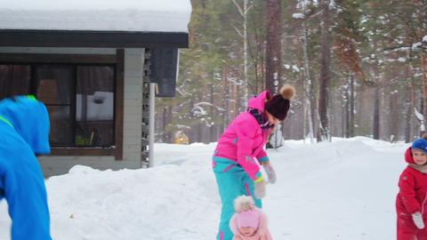 happy woman throws snowball and little girl kid smiles Live Action