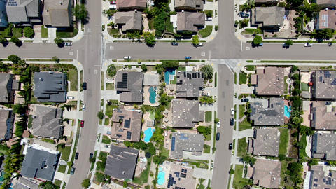 Aerial view of suburban neighborhood with big mansions in San Diego Live Action