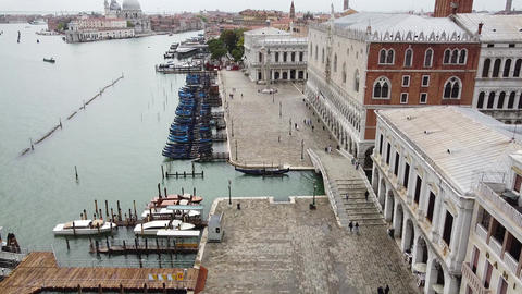 Venice on quarantine - gondolas and gondoliers waiting for tourists Live Action