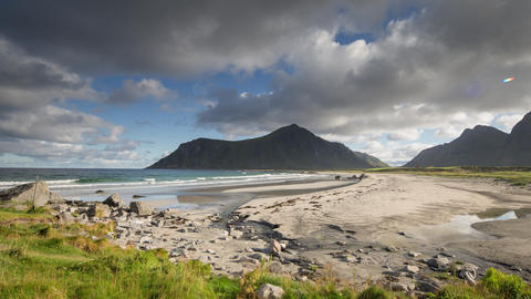 Loopable video of clouds and mountains on Lofoten beach, Norway Live Action