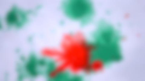 Blurred background. Colored paint splashes on white wet paper. Creative abstract Live Action