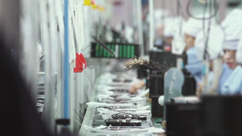 Assembly Line Workers in the Electronic Industry Live Action