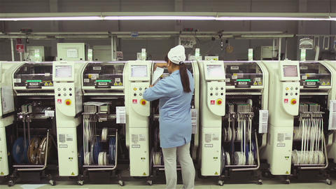 Female Worker in the PCB Assembly Plant Live Action