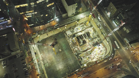 Night scene at Construction site. Aerial drone above huge Constructions with Live Action