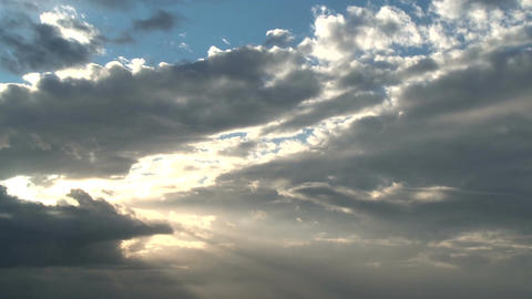 Time lapse of clouds with sunlight shining through Footage