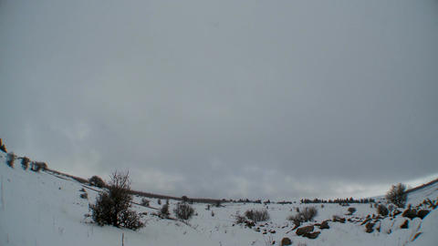 Clouds time lapse over snow landscape Footage