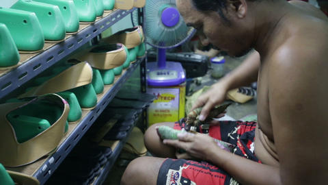Worker in a shoes factory Footage