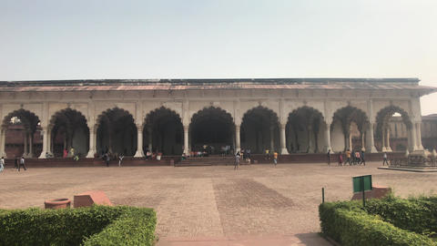 Agra, India, November 10, 2019: Agra Fort large white building with tourists Live Action
