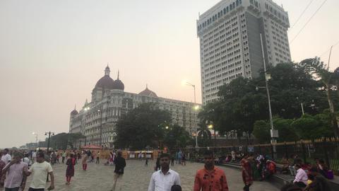 Mumbai, India - November 10, 2019: tourists walk along the embankment Live Action