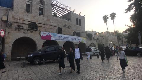 Jerusalem, Israel - October 20, 2019: tourists walk the streets of the modern Live Action