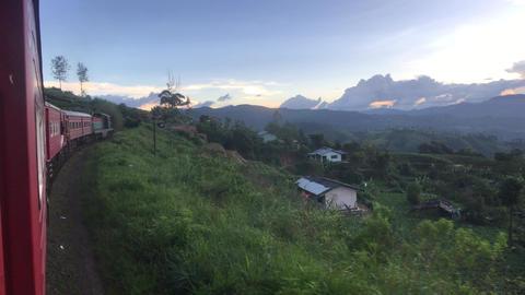 Ella, Sri Lanka, red train against the backdrop of tea plantations Live Action