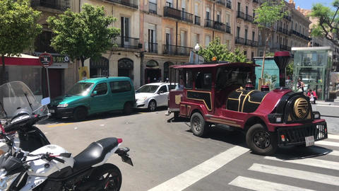 Tarragona, Spain, June 30 2019: A person riding a motorcycle on a city street Live Action