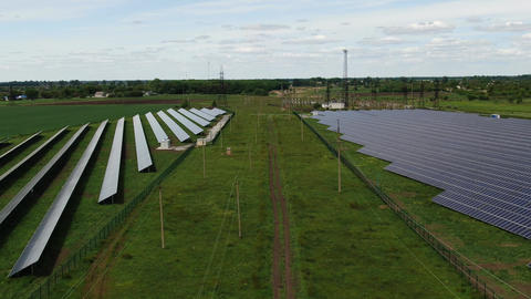 Dolly zoom on the footage of a big solar power station, aerial shot, 4k Live Action