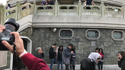 Hong Kong, China, November 20 2016: A person standing in front of a crowd Live Action