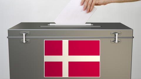 Flag of Denmark on ballot box and hand putting paper ballot, 3d rendering Photo