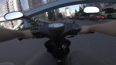 A point of view of driving by bike at the business street in Shinjuku Live Action