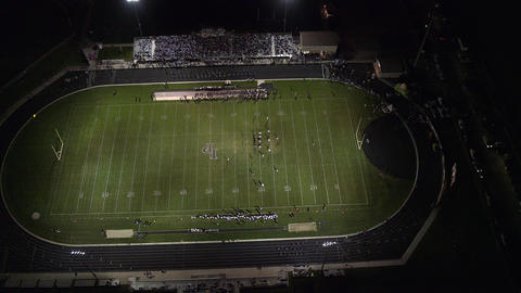 High aerial view of high school football game Live Action