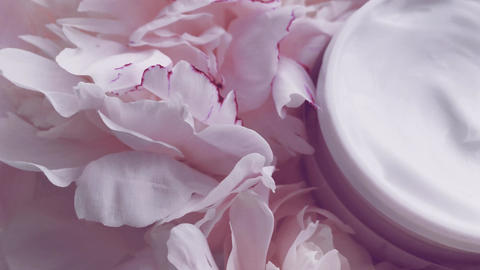 Mineral face cream jar and peony flowers, clean moisturizer as skin care routine Live Action