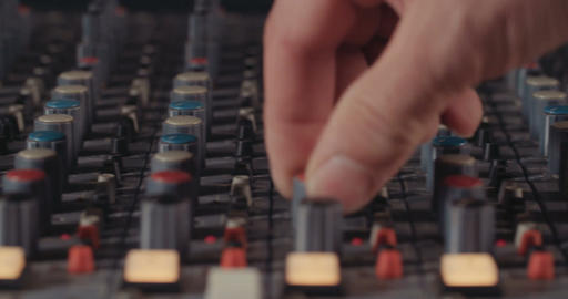 Sound engineer working in a recording studio, mixing sound Live Action