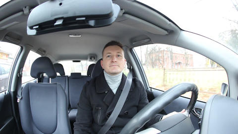 Man start drive car, front seat view, driver steer and wheel to main road Footage