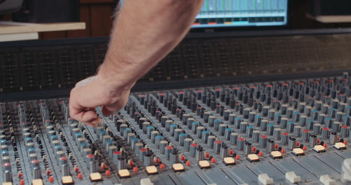Sound engineer working in a recording studio, mixing sound Footage