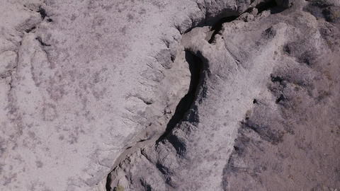 Aerial view looking down at eroded desert terrain Live Action