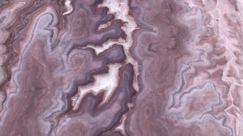Aerial view of colorful desert textured terrain in Mars like landscape Live Action