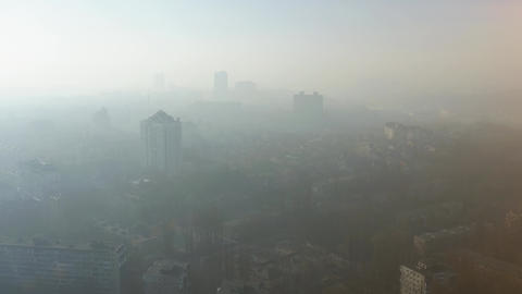Aerial View of a Dense Smog or Fog Hanging Over the City Air Environmental Pollution Concept Live Action