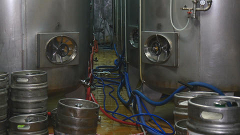 Beer Production in the Factory Brewhouse Malt Beer Is Cooled in Tanks Chill Fresh Beer Live Action